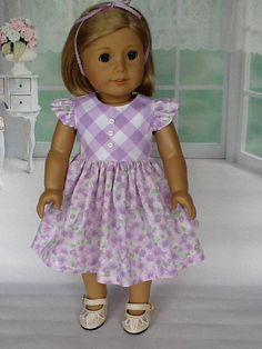 I chose two lilac fabrics for this retro style dress, a horizontal check, and a lilac floral. The bodice is lined with self fabric and closes in the back with working buttons and buttonholes . It has ruffled sleeves, belt ties, and white button down the center front. The full gathered