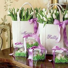 "Easter Favors | Here's a fun take on an Easter basket for adults. Fill custom L.L. Bean tote bags (visit llbean.com to design your own; $39.95 and up) with an abundance of bundled tulips. Grouped on a sideboard, the ""baskets"" become a pretty part of the decoration. 