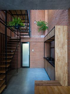 A brick wall arranged with holes allows sunlight to pour inside this unique Ho Chi Minh City residence by Tropical Space. via- designer, architecture Tropical Architecture, Brick Architecture, Architecture Details, Interior Architecture, Interior Design Magazine, Home Interior Design, Interior And Exterior, Interior Decorating, Design Living Room
