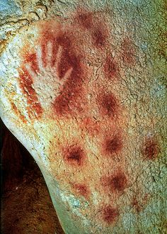 """The """"Main Négative"""" (= Negative Hand) in the caves of Pech-Merle in Cabrerets (Lot - 46), Southwestern France. Together with the Cosquer Cave near Marseille, Perch-Merle is the second oldest prehistoric site with artwork known to humanity. Stencil printed on the rock wall, the Negative Hand may be esteemed as something between 17.000 and 25.000 years old."""