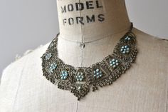 Vintage 1970s Afghan collar necklace with small turquoise flowers and adjustable length clasp. ------- M E A S U R E M E N T S -------  17 at longest