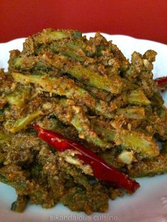 A super delicious way to eat Karela ! These are easy to make , and if you like your food spicy - this one is right up your street . Do try this recipe - always a big winner . Spicy Recipes, Curry Recipes, Vegetable Recipes, Indian Food Recipes, Asian Recipes, Cooking Recipes, Fish Recipes, Kerala Recipes, Cooking Tips