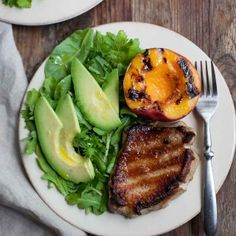 Grilled Pork Chops and Peaches. Pork chops and peaches grilled and served with greens and avocado. Ready in less than 30 minutes! Pork Rib Recipes, Grilled Steak Recipes, Grilled Pork Chops, Grilled Meat, Comidas Paleo, Recetas Whole30, Healthy Grilling Recipes, Paleo Recipes, Real Food Recipes