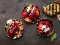 Red wine is reduced with spices and bright citrus zest and then drizzled over fresh strawberries, ice cream, and grilled bread in this delicious, simple dessert.