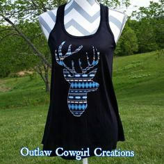 Bling Buck Aztec Loose fitting black tank top with bling deer print aztec Size available: S M L XL XXL $29.99 LIKE US AT OUTLAW COWGIRL CREATIONS FACEBOOK PAGE