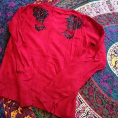 Red Rose Sweater Bright rose red button up sweater. Has two black glitter rose decals on back by shoulder blades. Excellent condition. Sweaters