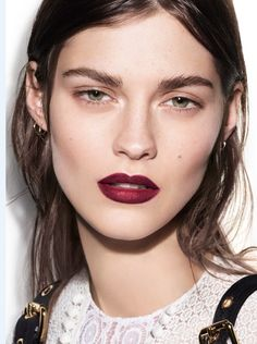 MAKEUP: Good news for fans of bold lippie: the focus has shifted from contoured complexions and heavily pencilled brows, back to the lips. Bright pouts were everywhere; from an oxblood red at Burberry to bright tomato shades at Céline.
