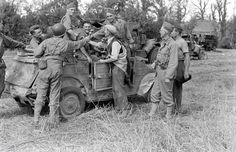 Americans celebrate with a captured Kubelwagen near the Poche de Falaise