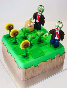 a small plants vs zombies cake with 3 types of plants. Zombie Birthday Cakes, Zombie Cakes, Birthday Ideas, Birthday Parties, Bolo Zumba, Fondant Cakes, Cupcake Cakes, Geeks, P Vs Z