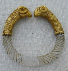 """Ram's head rock-crystal and gold bracelet styled like a torque (ca. Found in Macedonia, near Thessaloniki. From the collection of the Metropolitan Museum. """"The rock-crystal hoops of the bracelets have been carefully cut, carved, and polished Greek Jewelry, Ethnic Jewelry, Jewelry Art, Jewelry Design, Gold Jewelry, Roman Jewelry, Stone Jewelry, Ancient Jewelry, Antique Jewelry"""
