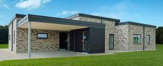 H-hus på 172 m2 med fladt tag og forhøjet midtersektion