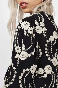 Go luxe with your outerwear in this intricate lace detail jacket. Featuring a stunning embroidery detail on a black base, this jacket comes in a boxy fit and is best styled with an all black ensemble for a contrasting feel. #Topshop
