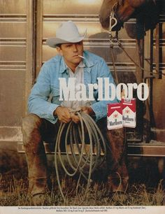 """realmensmoke:  """"  Marlboro Man 1980′s most likely from a German magazine ad.  Marlboro Man 1987  """"  It is indeed in German. It's a warning label that reads as follows:  The Federal Minister of Health (says): Smoking compromises your health. The smoke of a..."""