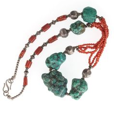 Vintage necklace of large gorgeous natural Tibetan matrix turquoise with sterling silver beads, multiple strand of tiny carved coral and large coral cylinders.   The silver beads test for 800  coin silver  The turquoise beads are natural and free form  the largest turquoise bead is 33x24x15mm and the smallest is 17x18mm.   The tiny coral beads are 2mm and the larger cylinders are approximately 9x5mm.   The neck