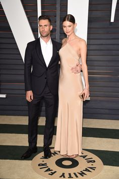 See What Everyone Wore to the Oscars After Parties  - ELLE.com  -  ADAM LEVINE AND BEHATI PRINSLOO