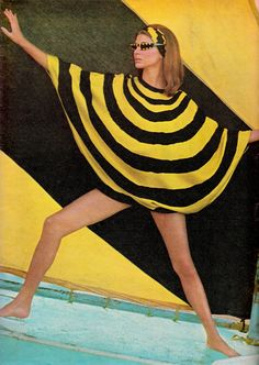 At Puerto Marquis Bay, a bright canary yellow & black circle playsuit by DANIEL BROOKS, is outlined against a matching sail. Photo (detail) by HOWELL CONANT for Life Australia April 3rd 1967. (minkshmink)