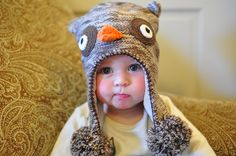 Owl hat, cute kid, excellent expression.