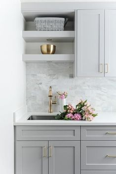 Laundry room designed with gray shaker cabinets, white quartz countertops and gray marble subway tiles for the win. Laundry room designed with gray shaker cabinets, white quartz countertops and gray marble subway tiles for the win. Home Decor Kitchen, Kitchen Interior, Home Kitchens, Kitchen Ideas, Grey Kitchens, Design Kitchen, Small Kitchens, Grey Laundry Rooms, Laundry Room Design