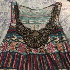 Aztec tank w/ wood bead embellishments Wood beading around neckline super cute! Flower and arrow print. Light flowy material Forever 21 Tops Tank Tops