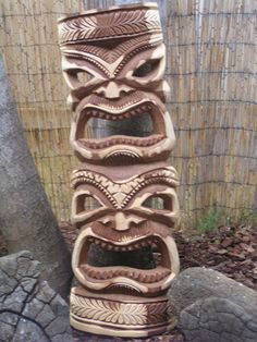 wood carved tiki mask totem