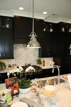 Dark cabinets with light counters and backsplash. Almost same layout as new house. Love this look