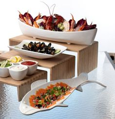 Bamboo Risers with our resin-coated aluminum Ocean them display pieces - perfect for a seafood buffet!