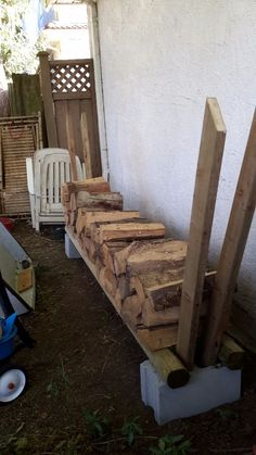 Breeze Blocks and Pressure Treated Timbers = Firewood Rack - * personal note: I'd probably place another breeze block or two under the center for additional support.