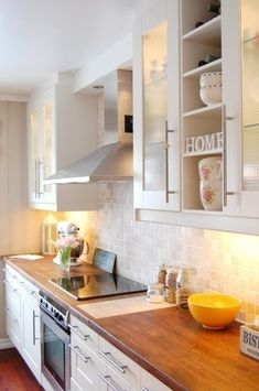 Simple.  White cabinets, glass tile backsplash, wood countertops.