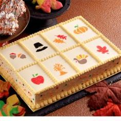 Use decorating stencils, sugars and Color Dust to create Thanksgiving images on this buttercream iced cake.