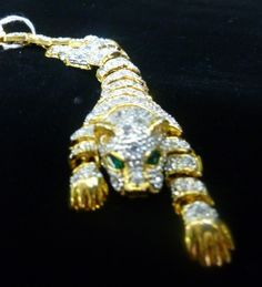 Rhinestone Set in Goldtone Tiger Shoulder Pin - $125.00
