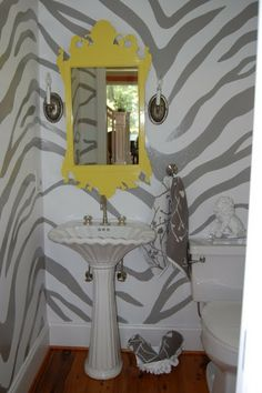 Pretty towels from HomeGoods soften this powder room with hand-painted walls.