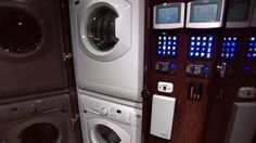 Digital climate and electronic utilities control, along with a washer and dryer unit, make this specialty RV by Featherlite as unique as they come.