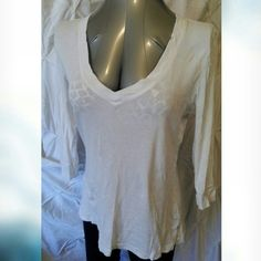 Gap long sleeve v-neck tee shirt white Gap long sleeve v-neck tee shirt   White  Good condition did not see any stains etc.  60% cotton 40% modal  Measurements laying flat  Length 25 in. Chest 38 in. Sleeve 13 in. ❤pictures are part of the description  ❤️No trades or off site transactions/communications ❤️Open to reasonable offers ❤️same day shipping Mon-Sat if purchased before 2:30pm central time  ❤️4.9 rating  ❤️Please ask questions all questions BEFORE buying. ❤PLEASE do not rate me on…