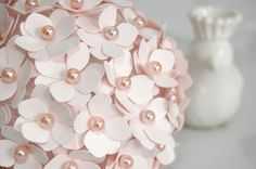 Step-by-step instructions for an elegant paper pomander. Floral paper punch, styrofoam balls, and pearl-tipped pins. Love it - very chic!