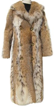 Lynx Fur Coat #L537; $1150; Excellent Condition; Size range: 0 - 4 (possibly 6) Petite. This is a fantastic genuine lynx fur coat that has loads of gorgeous lynx spots. It features a beautiful, very large notched collar and has two exterior pockets and a pocket hidden in the lining.  It closes with buttons (which could be easily removed and have traditional closures added instead if you don't like them) and there is a button at the collar for those extra cold days. Your wild side will emerge!