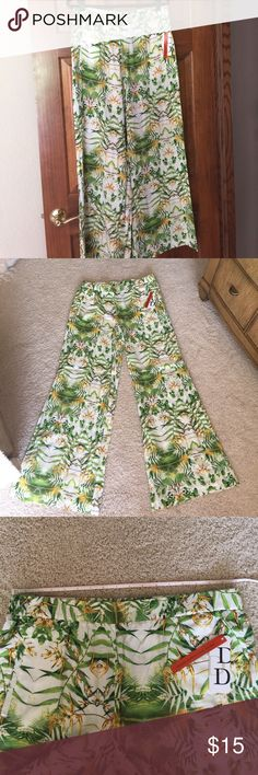 Dalia city fit pants. These brand new with tags Dalia pants have a summery floral print. They are a size 12 with an elastic waist. They do have a wide leg. The tag says they are called the city fit. Dalia Pants Wide Leg