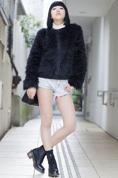 Harajuku, TOKYO. Emi Ogihara, student. John Lawrence Sullivan jacket, Jeanasis sweater, Comme des Garçons bag, Ingni short pants, Dr. Martens shoes. Photo Steve West