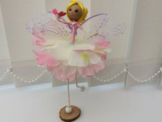 Meet Fauve.💕💕💕💕 Fauve is a Flower Fairy doll and she is wearing a silky pink bodice and a milky white and pale pink peony skirt and white shoes. Her skirt is very light and delicate and flutters gently in the breeze. Fauve is gazing at a butterfly which has come to rest on her