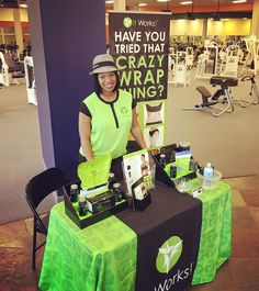 Adrienne Sifontes showing off her beautiful It Works vendor Table Display featuring two displays from Stack Displays! Also shown is the new brochure holder now available from Stack Displays!