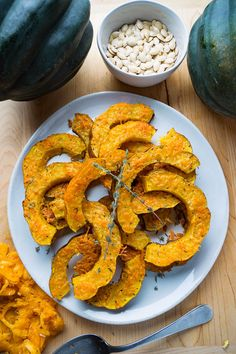 Quick, easy and tasty roasted acorn squash covered in melted parmesan cheese! Pumkin Seeds, Toasted Pumpkin Seeds, Thanksgiving Recipes, Fall Recipes, Lunch Box Recipes, Acorn Squash, Side Dishes Easy, Parmesan, Food To Make