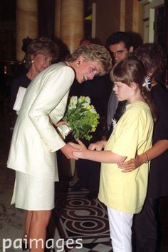 June 29 1993  Princess Diana meets 11-year-old Lisa Herman, who is blind, on her arrival at a Lunch and Fashion Show in aid of the Chicken Shed Theatre Company Building Fund.