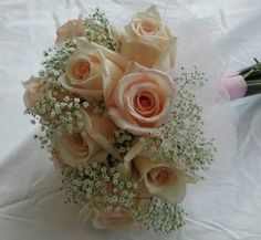 Hand-Tied Bouquet Featuring Pink Roses and Baby's Breath