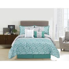Update your bedroom with this aqua and grey geometric 7-piece printed comforter set with decorative pillows. The comforter and shams reverse to a aqua solid for a versatile look.