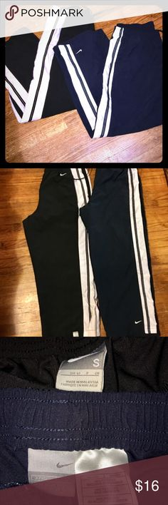 2 Pair Of Nike Capris Navy and black in color. S/M in sizes Nike Pants Track Pants & Joggers