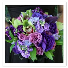 deep blues purples accented with green cymbidium orchids