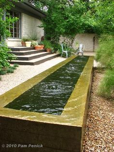 negative-edge concrete trough fountain
