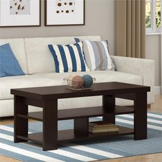 Add the finishing touch to your living room with the Altra Contemporary Coffee Table. This table has two lower shelves and a large tabletop shelf for decor.