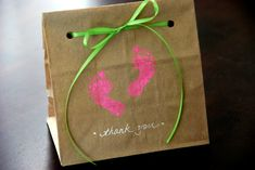 Need a cute, easy and inexpensive way to say thanks to your shower guests? Generic brown paper lunch sacks transform into chic favor bags with the help of a little ribbon, rubber stamping and decorative cutting. You could build on these in a number of ways – using white paper sacks with jute twine, or yarn for ribbon would also be cute. Get creative!