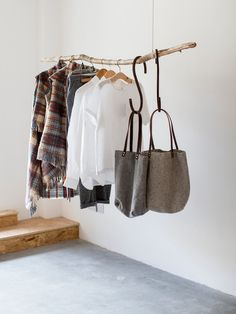 minimal art with hanging clothes closet sc andinavian and wooden clothes hangers Trash To Couture, Hanging Clothes, Diy Clothes, Clothes Hangers, Clothes Storage, Clothing Racks, Diy Jeans, Minimal Decor, Hanging Racks