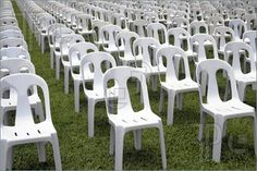 Picture of rows and columns of white monoblock chairs